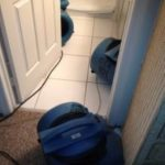 water damage at toilet ServiceMaster by Wright